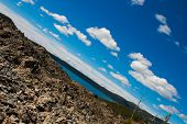 stock photo of obsidian  - obsidian flow in Oregon with paulina lake as a background - JPG