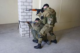 stock photo of ak-47  - insurgents with AK 47 ang RPD gun inside the building - JPG