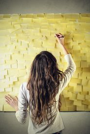 foto of post-teen  - Woman writing on a wall of post - JPG