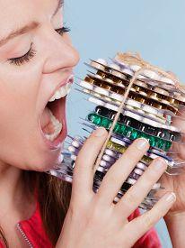 foto of overdose  - Woman taking pills - JPG