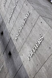 stock photo of poitiers  - Names of French towns on a concrete wall Montparnasse railway station - JPG
