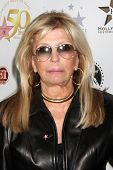 LOS ANGELES - NOV 3:  Nancy Sinatra arrives at the Hollywood Walk of Fame 50th Anniversary Celebrati
