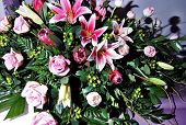 picture of funeral  - Beautiful funeral spray atop a casket in the viewing room - JPG