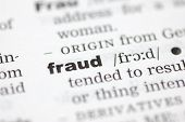 stock photo of pronunciation  - A close up of the word fraud from a dictionary - JPG