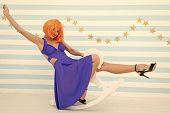 Girl Wig Rides Swing Little Horse. Feel Childish. Lady Red Or Ginger Wig Blue Dress Rides Rocking Ho poster