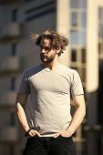 Stylish Concept. Stylish Man In Casual Wear On Sunny Outdoor. Guy With Stylish Hair On Wind. Stylish poster