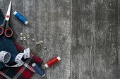 Sewing Accessories, Jeans And Plaid Fabric On A Dark Wooden Background. Fabric, Sewing Threads, Need poster