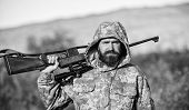 Guy Hunting Nature Environment. Bearded Hunter Rifle Nature Background. Hunting Big Game Typically R poster