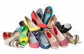 Pile of various female summer shoes, with clipping path