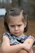 image of pouting  - Arms crossed and eyebrows puckered this little girl is upset and pouting - JPG