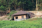 picture of landslide  - Broken and damage of house by landslide - JPG
