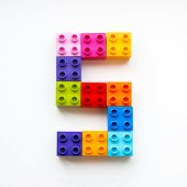 Number Five Made Of Colorful Constructor Blocks. Toy Bricks Lying In Order, Making Number 5. Educati poster