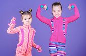 Active Lifestyle. Sport And Fitness For Kids. Cute Sisters Doing Gym Fitness Exercises With Dumbbell poster
