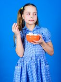 Sweets The Only True Love. Sweet Tooth Concept. Calorie And Diet. Girl Calm Face Blue Dress Hold Bow poster