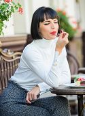 Delicious Gourmet Cake. Woman Attractive Brunette Eat Gourmet Cake Cafe Terrace Background. Gastrono poster