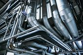 Industrial Steel Pipes Or Tubes Of Air Ventilation System As Abstract Industry Equipment Background  poster