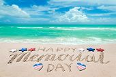 Memorial Day Background On The Sandy Beach Near Ocean. Hand Drawn Lettering Typography. poster