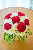 red Carnation bouquet using in wedding or any greeting ceremony