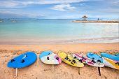 picture of dua  - Surf boards on idyllic tropical sand Nusa Dua beach - JPG