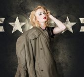pic of army cadets  - Old fashion fine art portrait of a blond military pinup girl wearing vintage model makeup and 60s hair style provoking a sensual look in retro army clothes - JPG