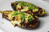 picture of aubergines  - two stuffed aubergines stuffed with minced meat and cheese - JPG