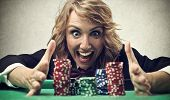 stock photo of lottery winners  - woman playing at the casino - JPG