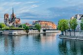 foto of notre dame  - notre dame de paris and the seine river France in the city of Paris in france - JPG