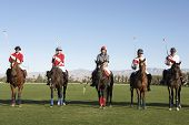 stock photo of umpire  - Polo players and umpire mounted on horses on field - JPG