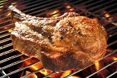 image of pork cutlet  - Grilled pork chop on the flaming grill - JPG