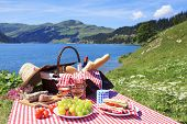 stock photo of tomato sandwich  - Picnic in french alpine mountains with lake - JPG