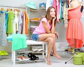 stock photo of mall  - Beautiful girl thinking what to dress in walk - JPG