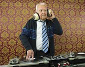 stock photo of grandpa  - a very funky elderly grandpa dj mixing records - JPG