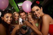 foto of limousine  - Bachelorette party in limousine with attractive young people - JPG