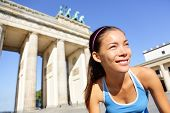 Runner woman running in Berlin, Germany by Brandenburg Gate. Athlete jogging living healthy lifestyl