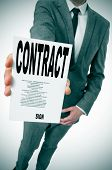 man wearing a suit showing a contract