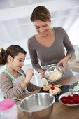 pic of cream puff  - Mother and daughter preparing cream puffs - JPG