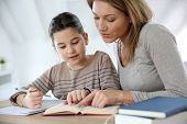 image of homework  - Mom helping kid with homework - JPG