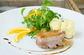 stock photo of duck breast  - Roasted duck breast served with mashed potatoes and orange fresh salad and white wine sauce - JPG
