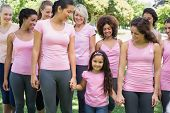 stock photo of charity relief work  - Group of women with girl supporting breast cancer campaign in park - JPG