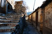 stock photo of hustle  - There is a small village deep in the Taihang Mountains in Shanxi Yue Zhai Feng quaint stone village where the road into town a stone house only the elderly and young children there is no hustle and bustle of the city but there are some fun - JPG