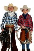 foto of western saddle  - cowboys wearing hats holding saddle and rope - JPG