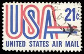 USA-CIRCA 1971: A 21 cent United States Airmail postage stamp shows image of Jet and text USA in red