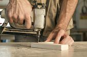 foto of joinery  - joinery uses a nail gun to attach pieces of wood - JPG