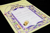 stock photo of rabbi  - wedding rings and Ketubah - a prenuptial agreement in jewish religious tradition