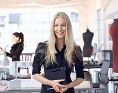 image of entrepreneur  - Happy female fashion designer entrepreneur at creative studio leading small business - JPG