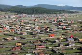 image of ulaanbaatar  - The sweeping remote hills of Mongolia are marked only by primitive roads and clusters of simple cabins - JPG