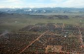 foto of ulaanbaatar  - The sweeping remote hills of Mongolia are marked only by primitive roads and clusters of simple cabins - JPG