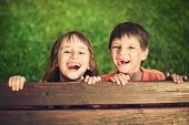 picture of toothless smile  - Outdoor portrait of smiling girl and boy who lost his milk teeth - JPG
