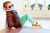 picture of jacket  - cute stylish boy in leather jacket and gum shoes - JPG