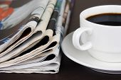 pic of mass media  - Pile of newspapers and cup of coffee on the table - JPG